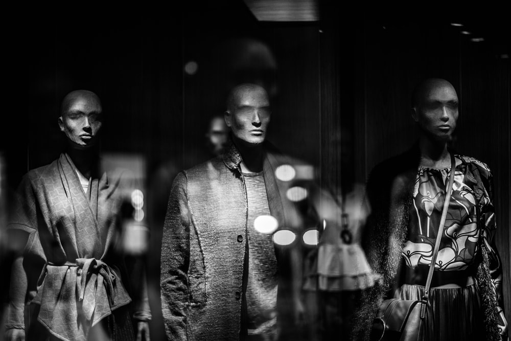 grayscale photography of mannequins wearing shirts
