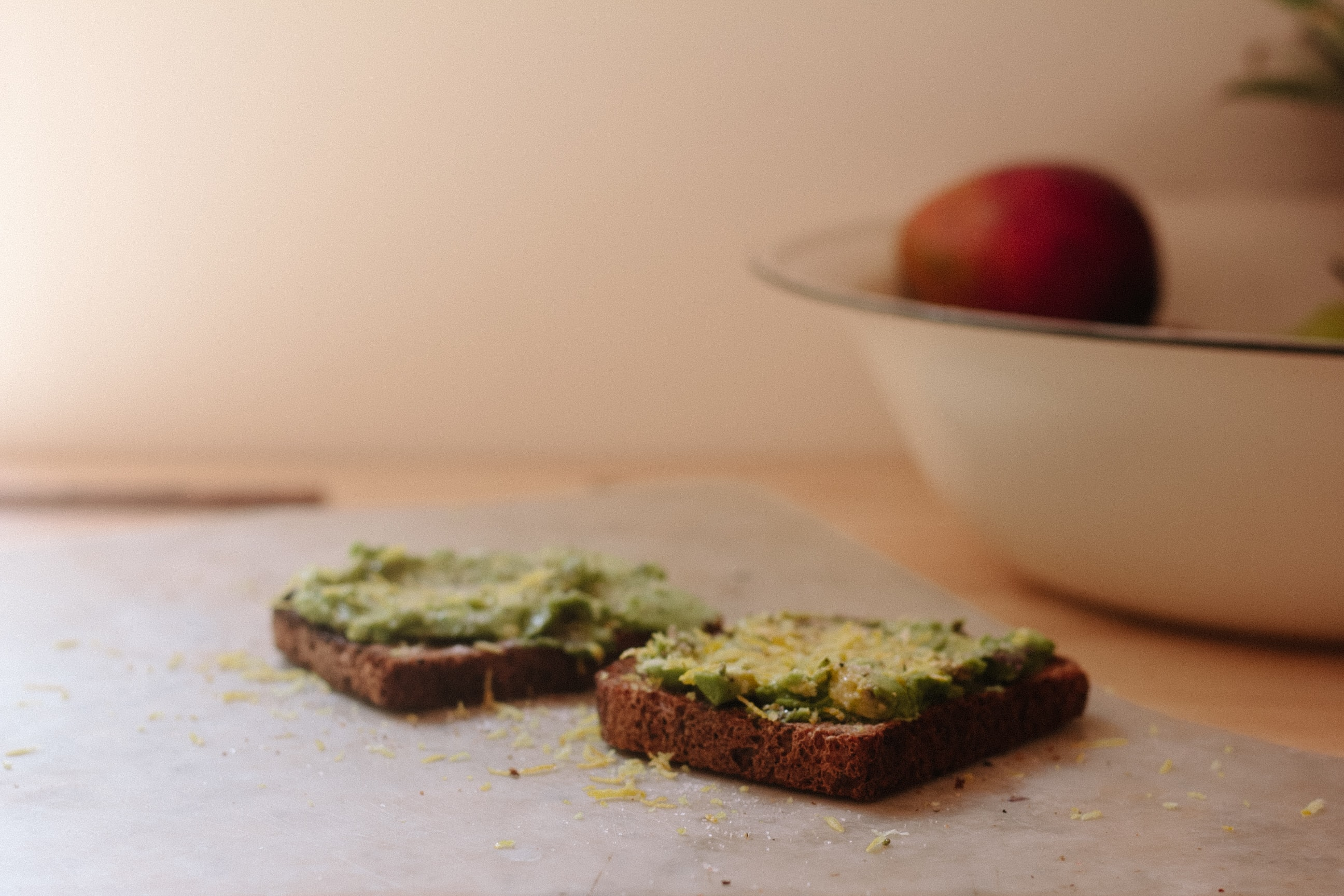 two toasted breads on chopping board