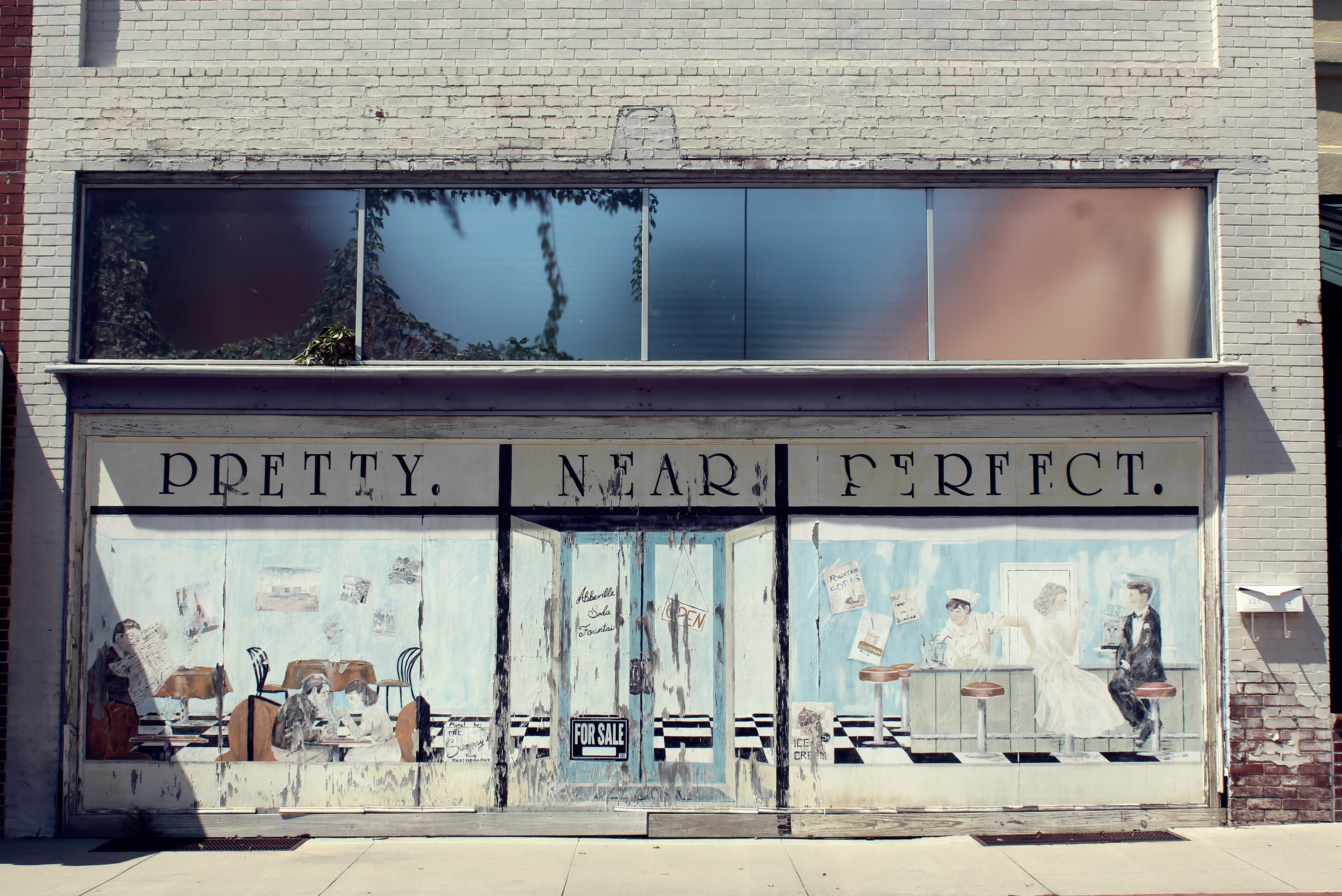 Another abandoned storefront in Abbeville, SC. This one I really love because of the washed-out, muted colors, and the painted scene has the perfect air of nostalgia.