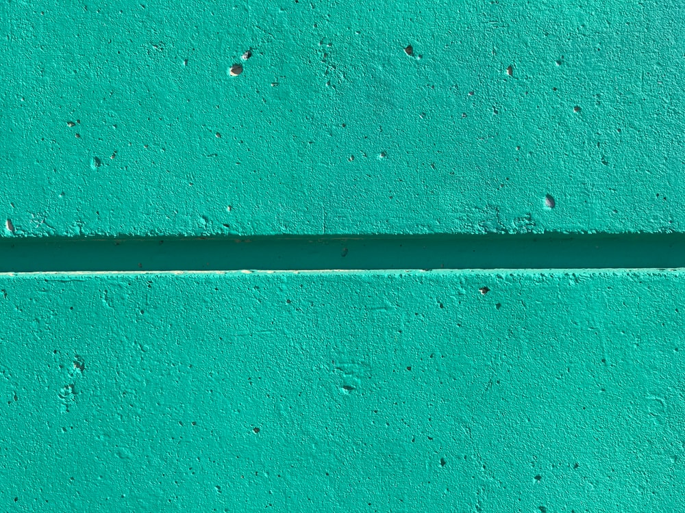 close view of teal color wall