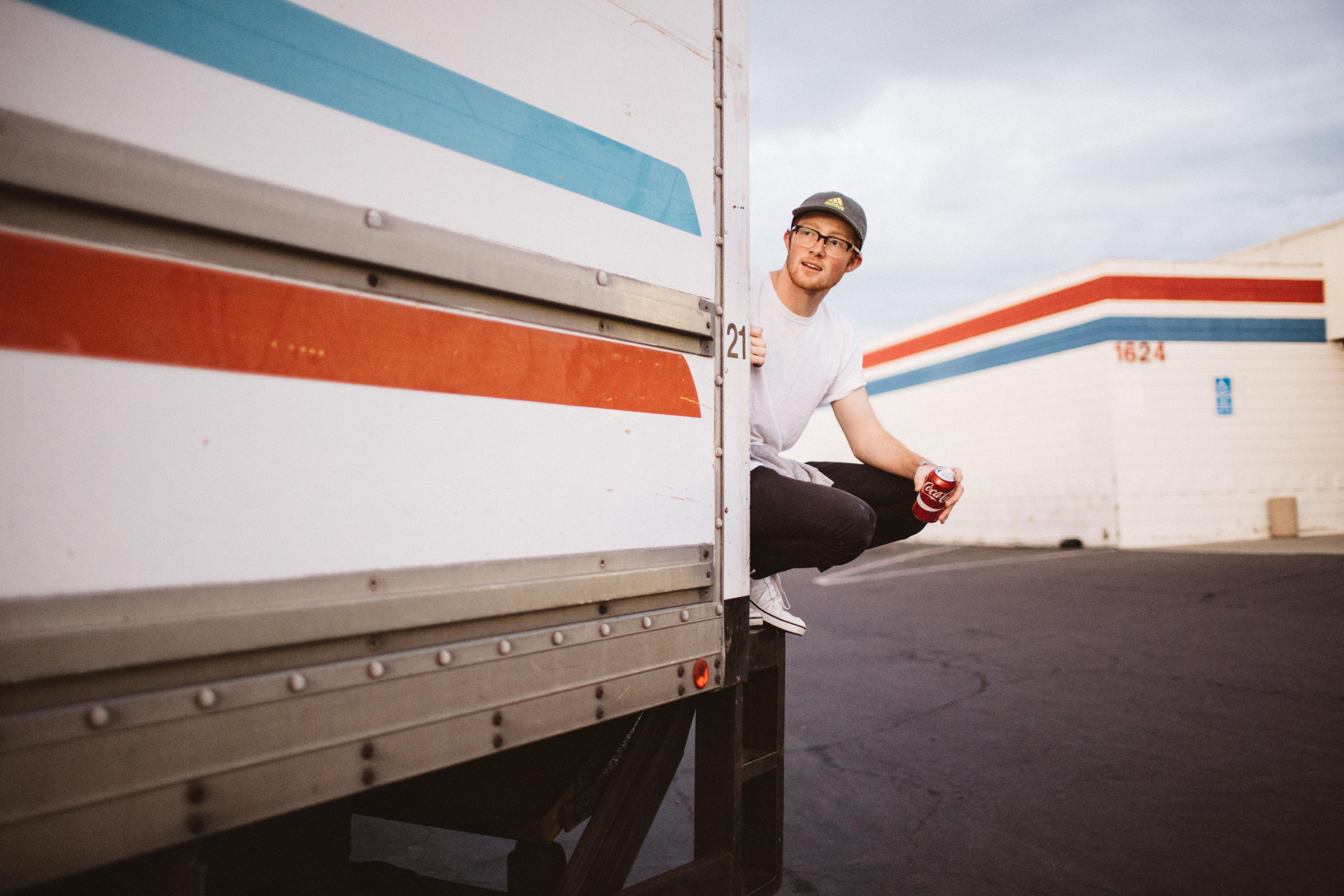 man on truck during daytime