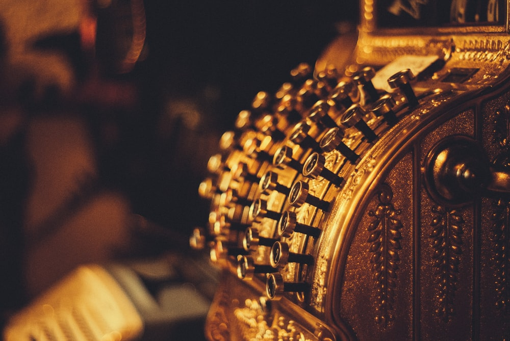 closeup photography of gold-colored ornament