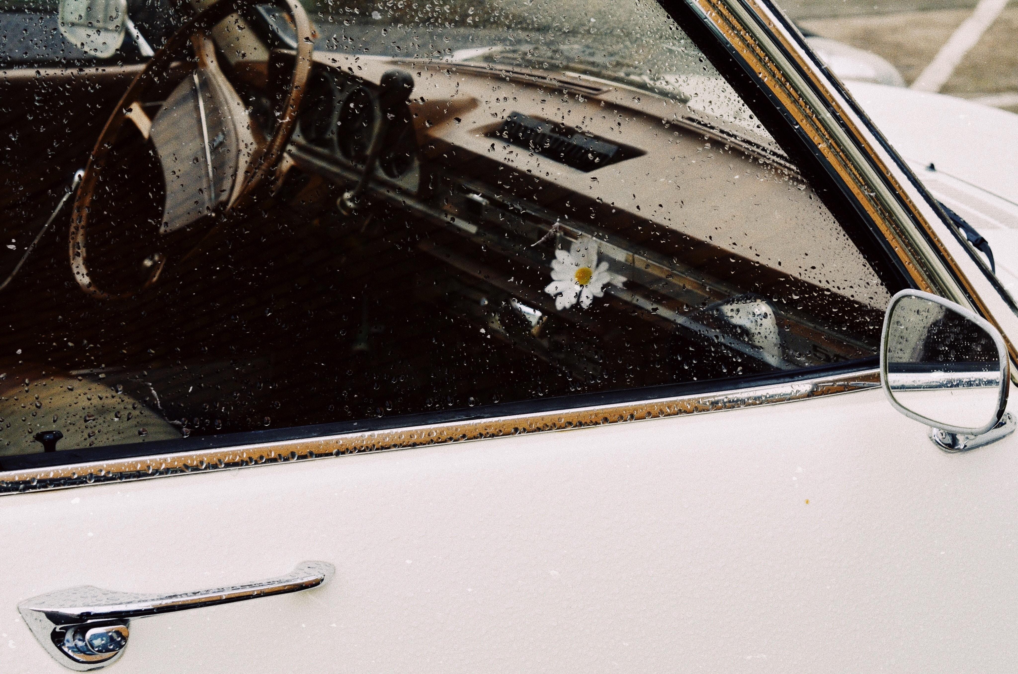 white car with rain drops