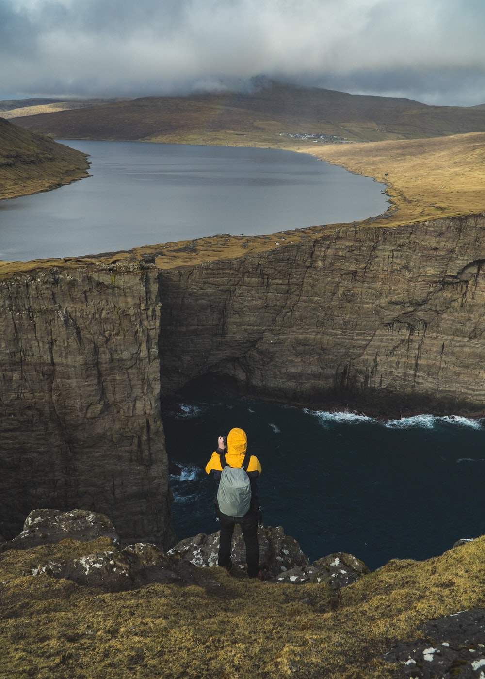man standing on the edge of the cliff