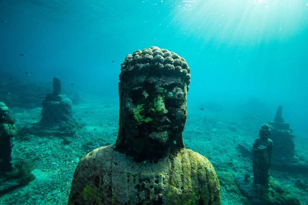 human concrete statue deep in water
