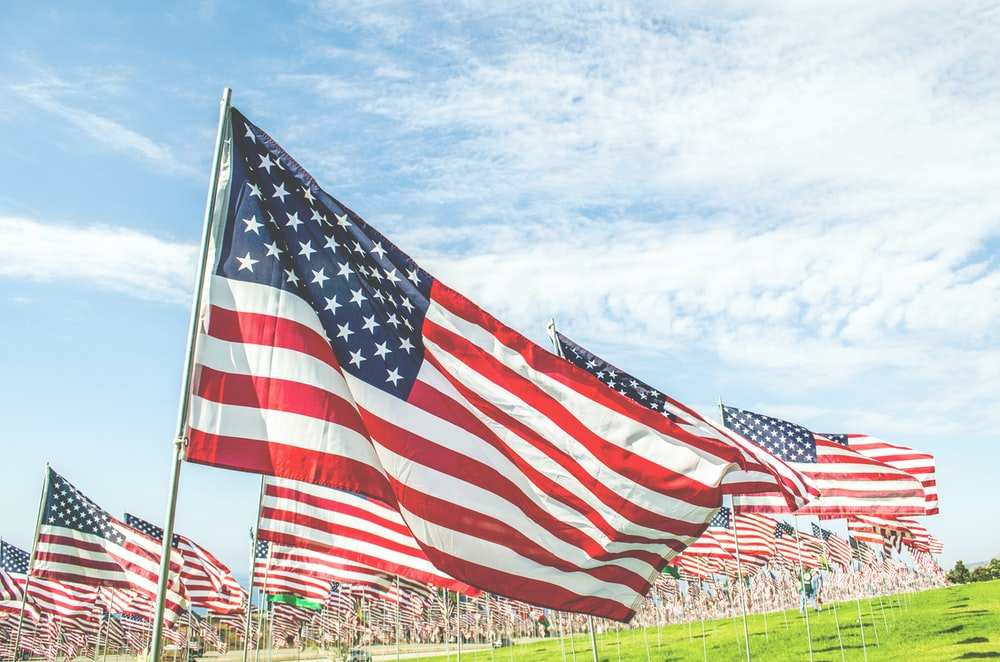 flag of U.S.A. on green grass field