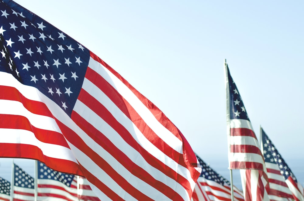 US flags under clear sky