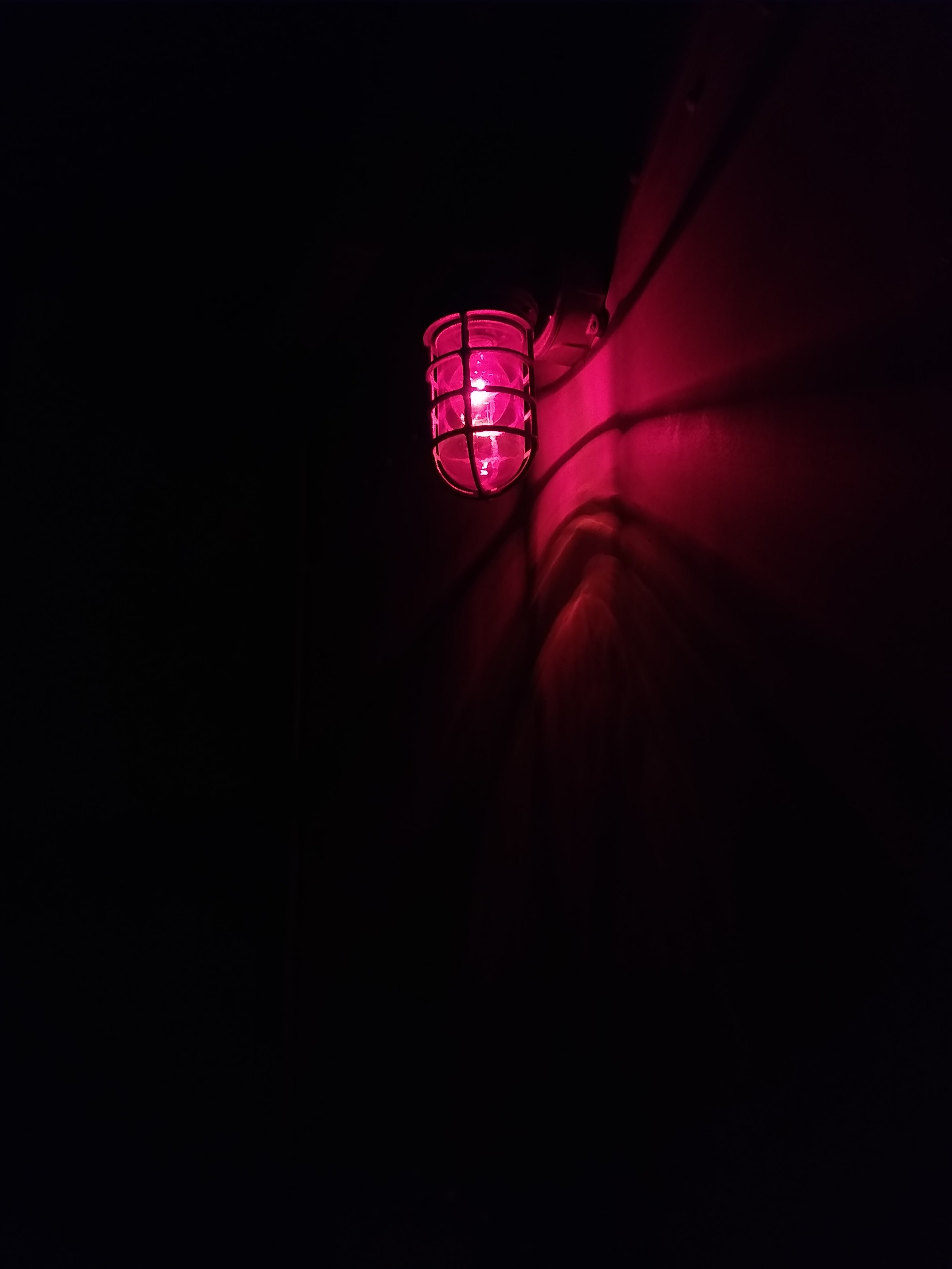 red light bulb on wall