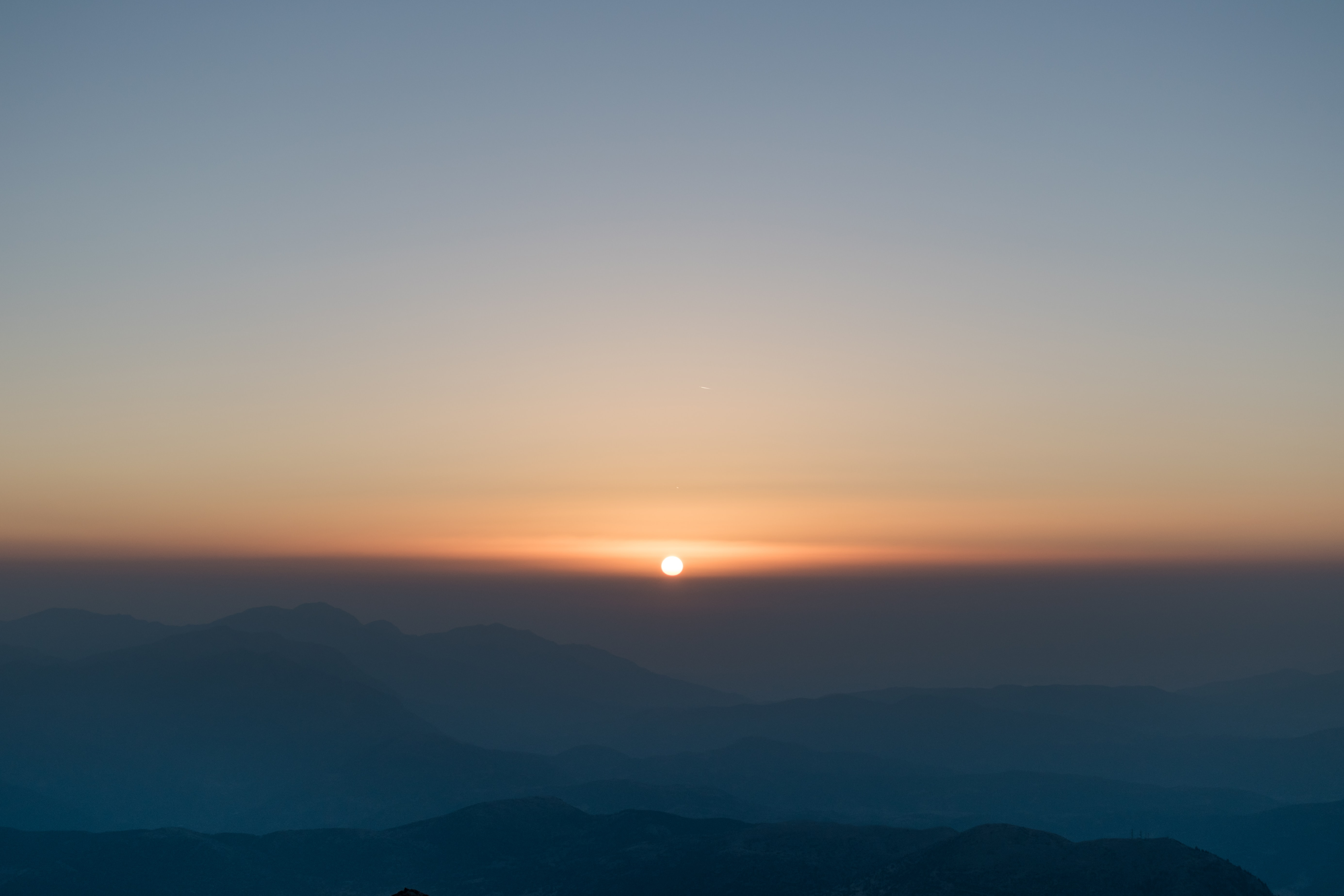 sunrise in front of mountain