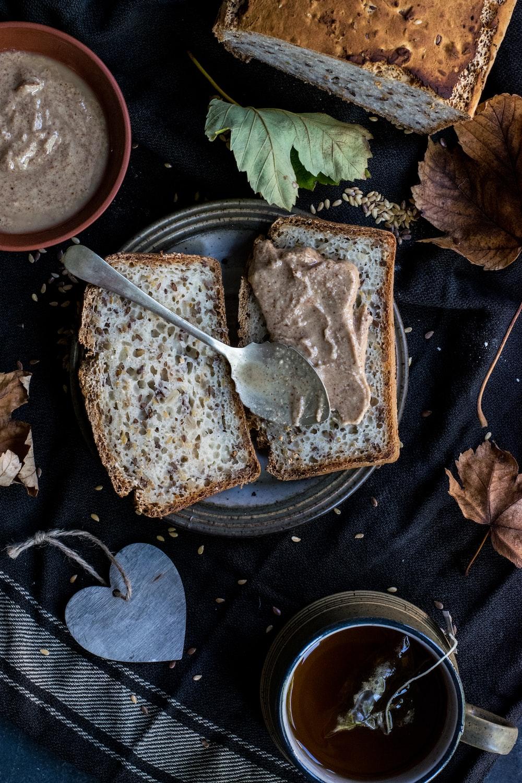 silver spoon on bread