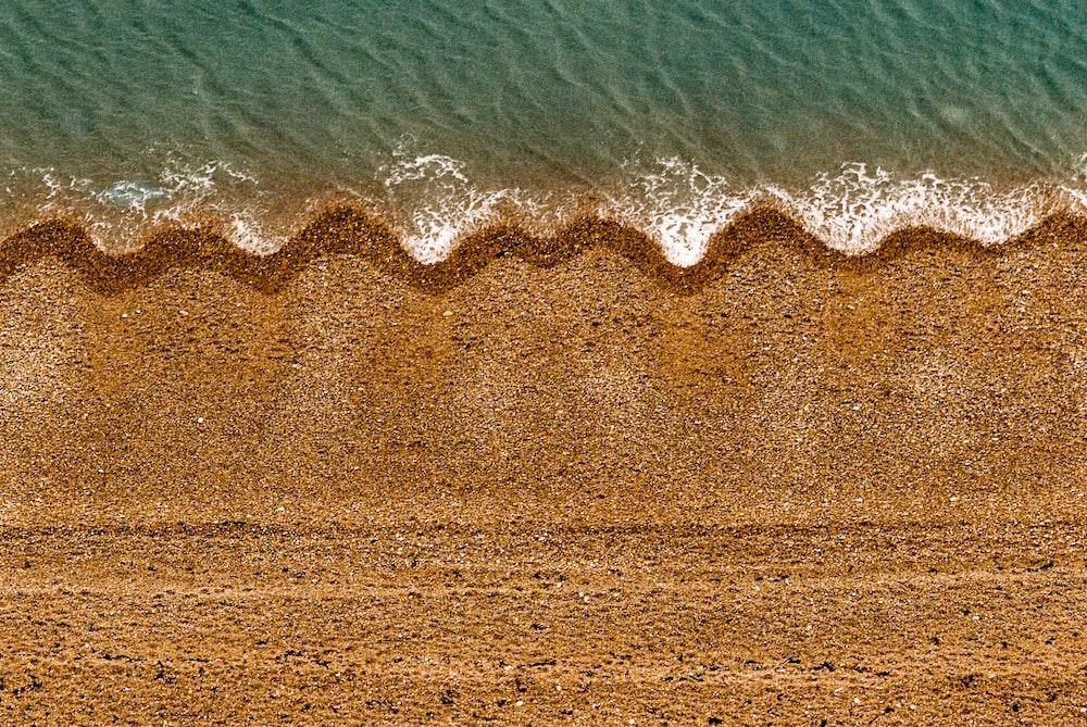 ocean wave on seashore during daytime