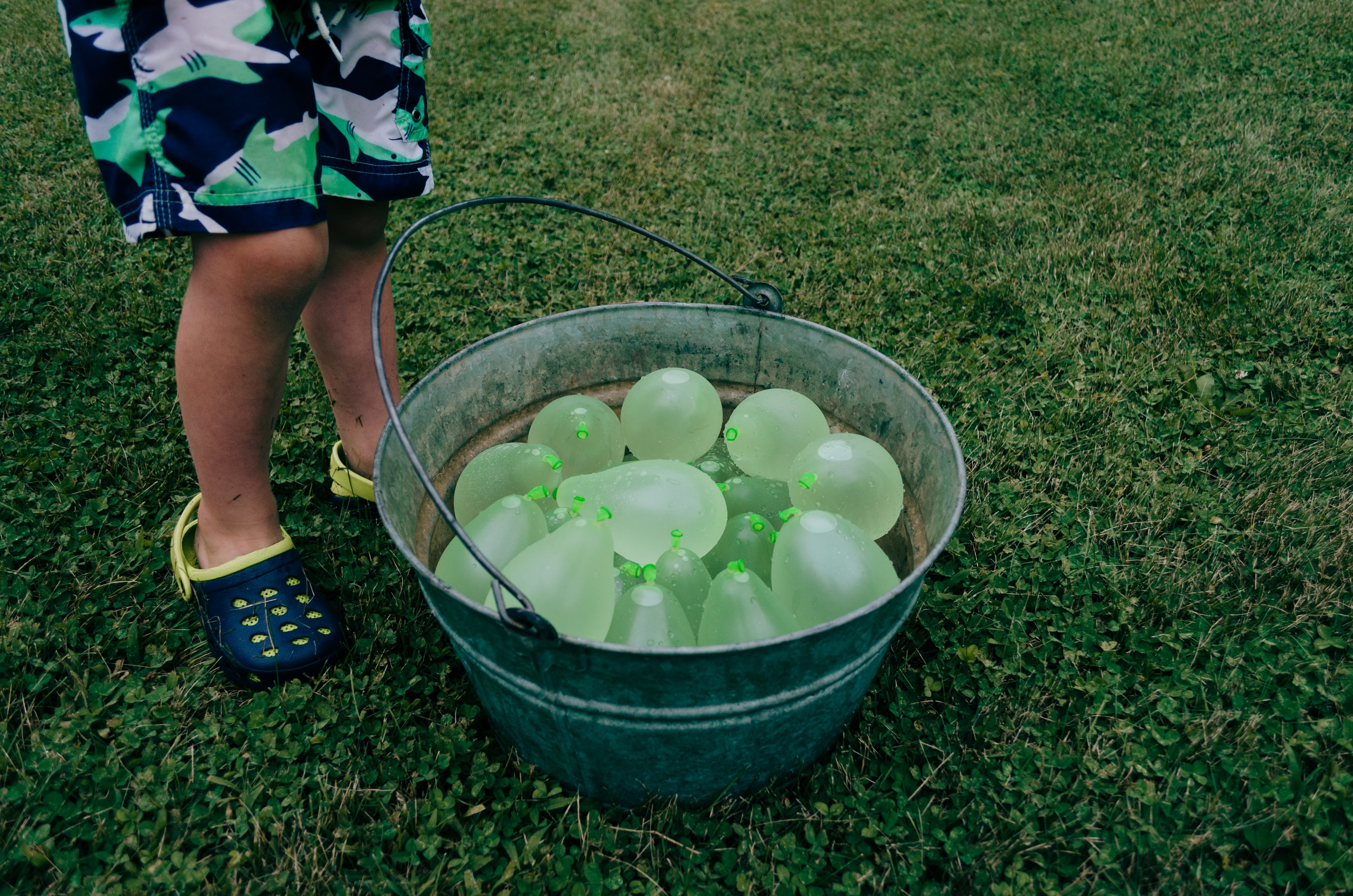 green balloons on gray stainless steel bucket