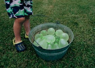 green balloons on gray stainless steel bucket
