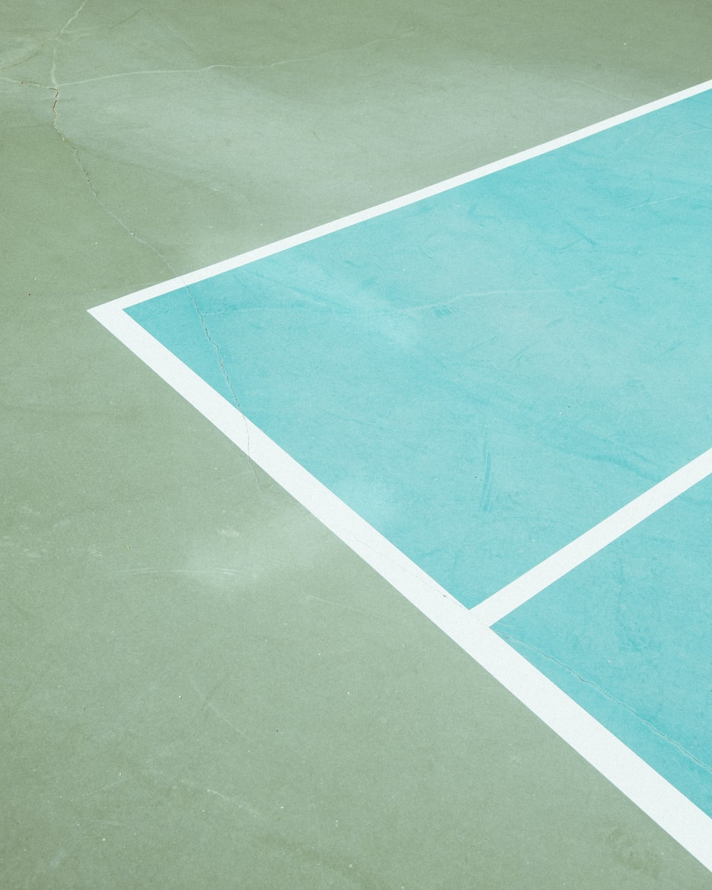 teal and green concrete flooring