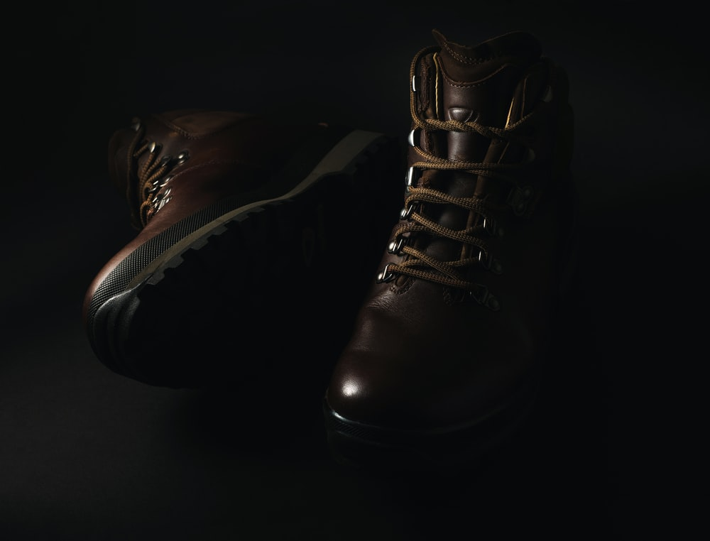 pair of brown leather lace-up combat boots