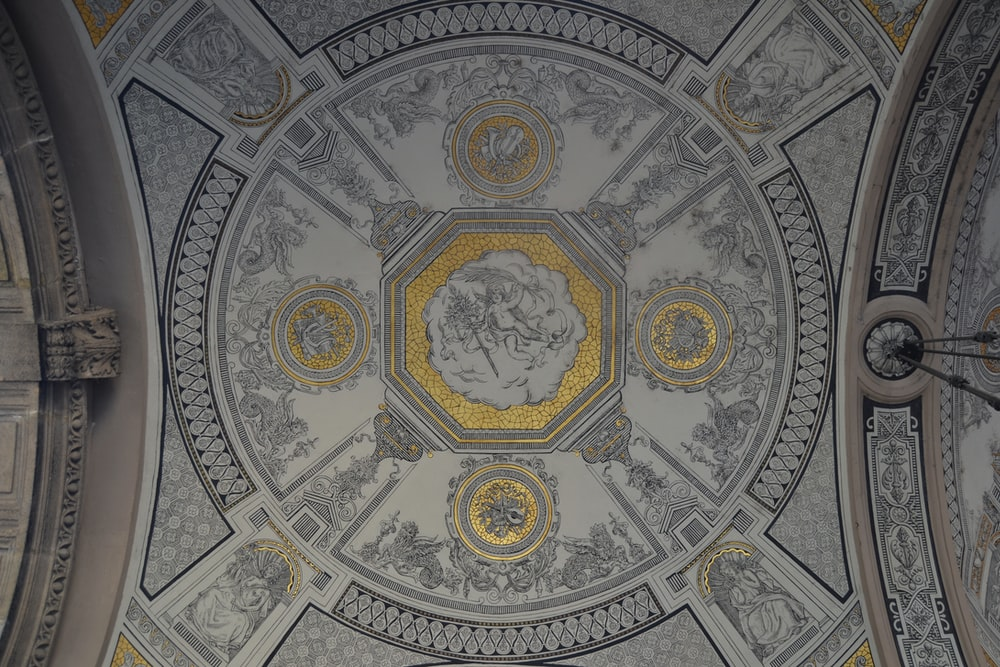 photo of white, gray, and yellow building ceiling