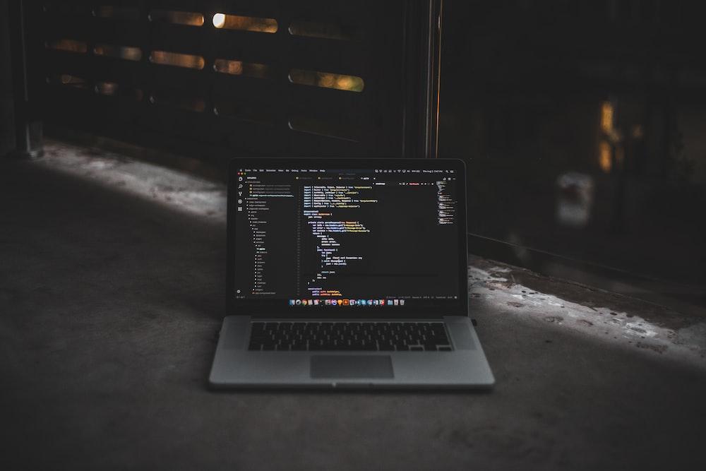 MacBook Pro inside gray room