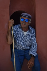 man with sunglasses sitting
