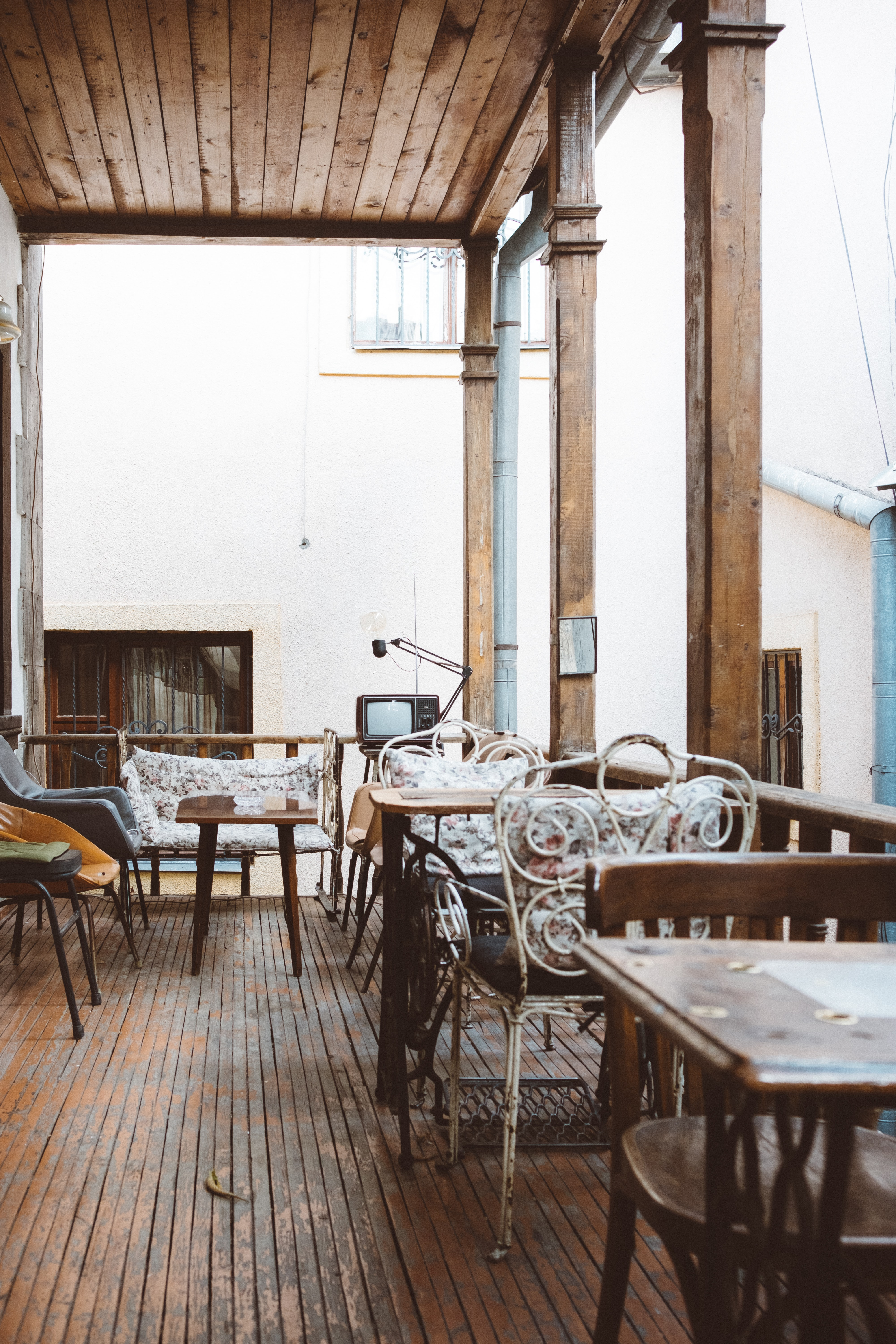 white metal chairs and tables at daytime