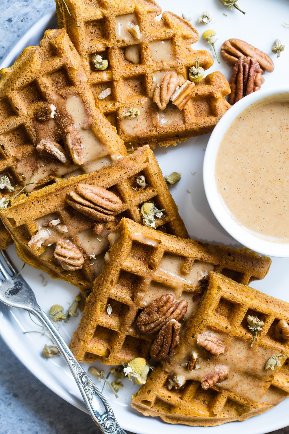 waffle with cream on white ceramic plate