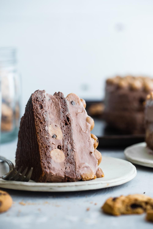 slice of chocolate cake on white ceramic saucer