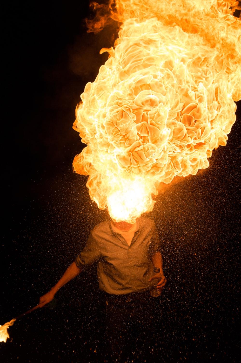 man spitting fire