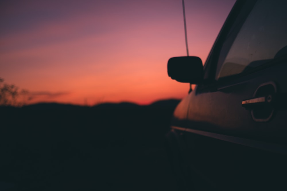 black vehicle during sunset