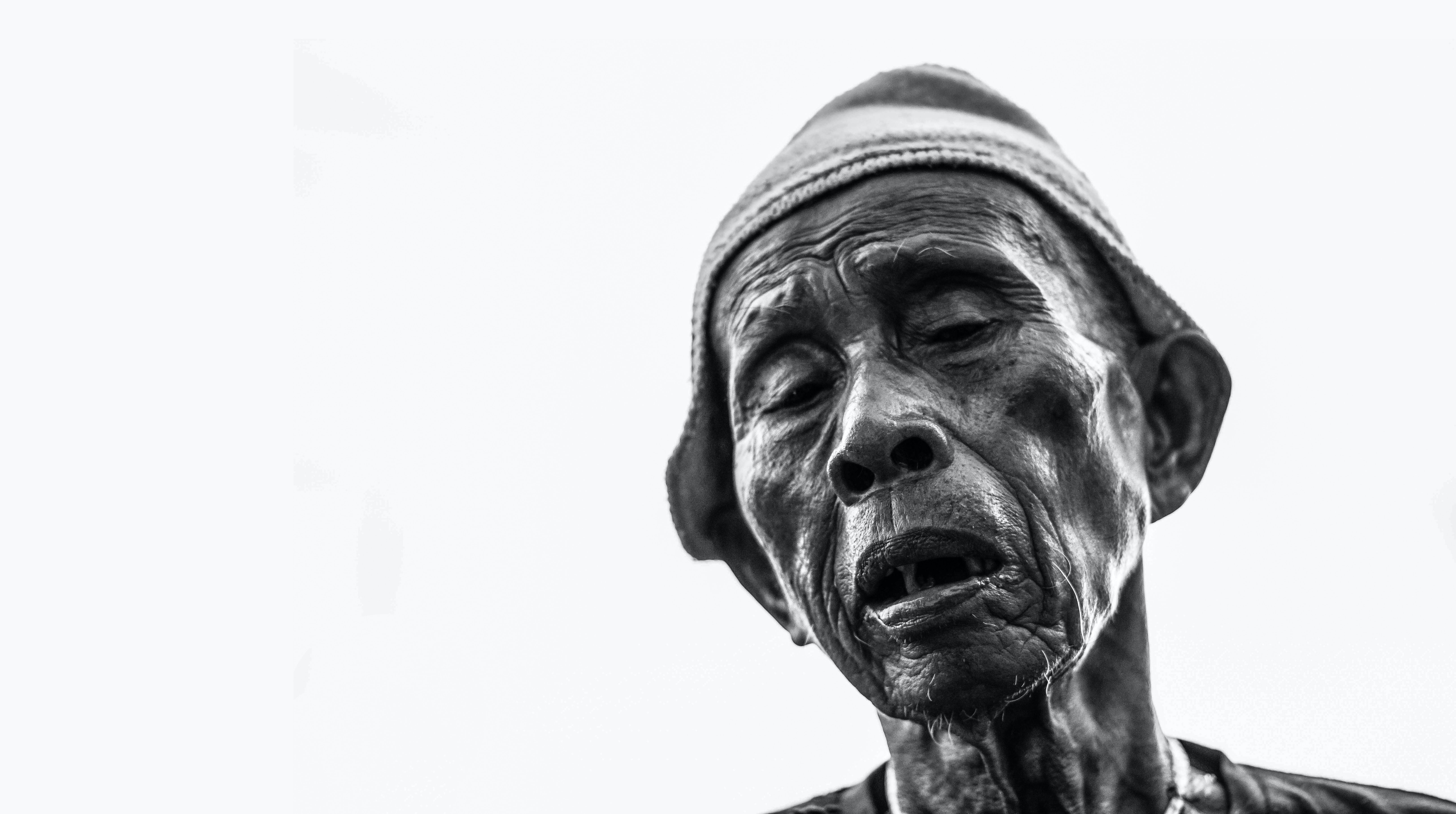 man face grayscale photography