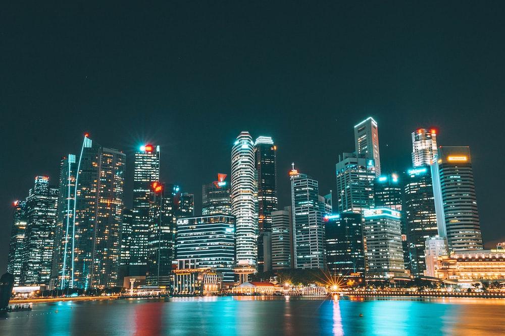 city lights under black clouds