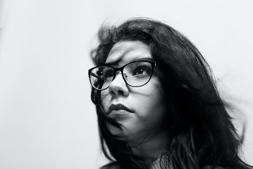 grayscale photography of woman wearing eyeglasses
