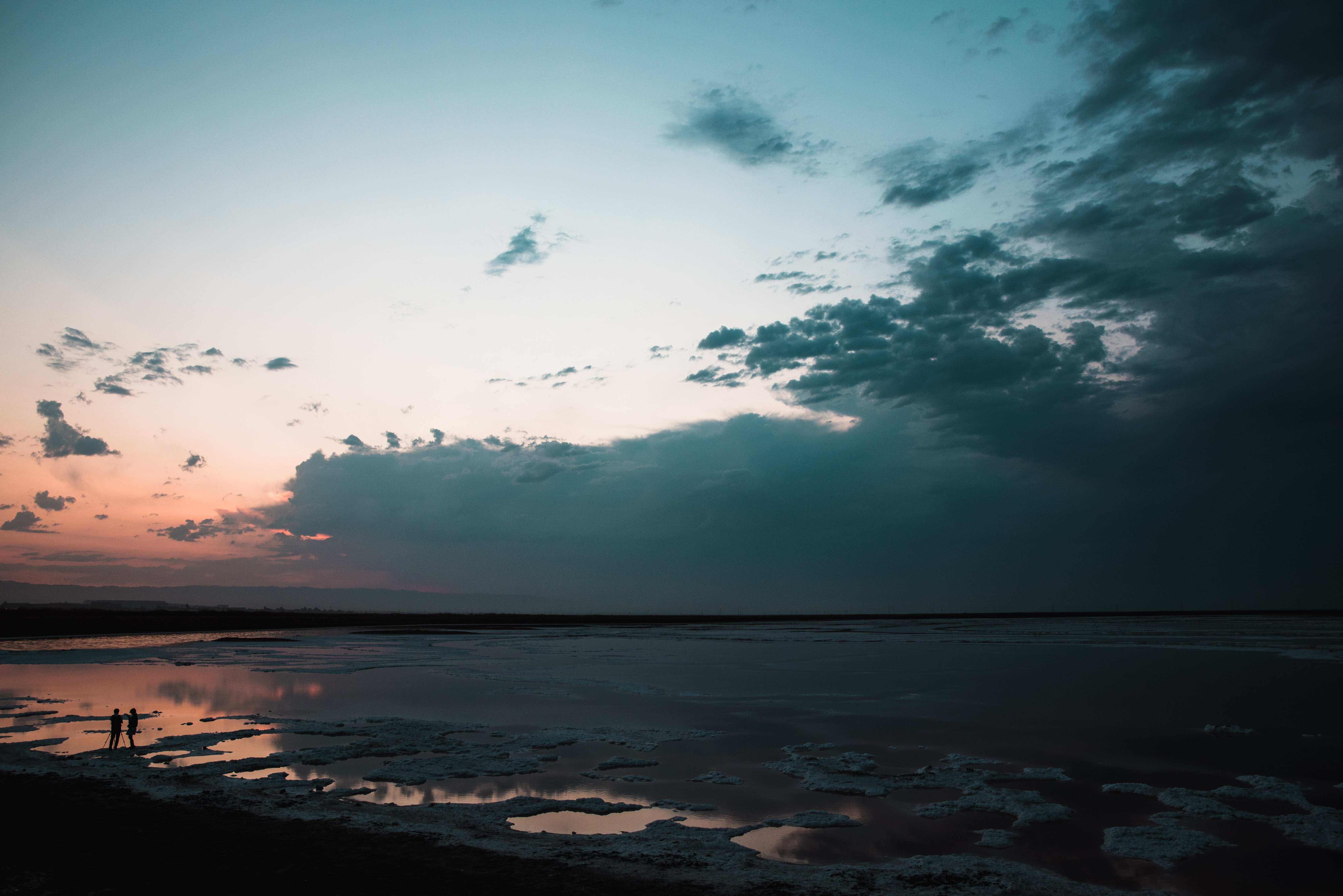 body of water under blue and white cloudy sky