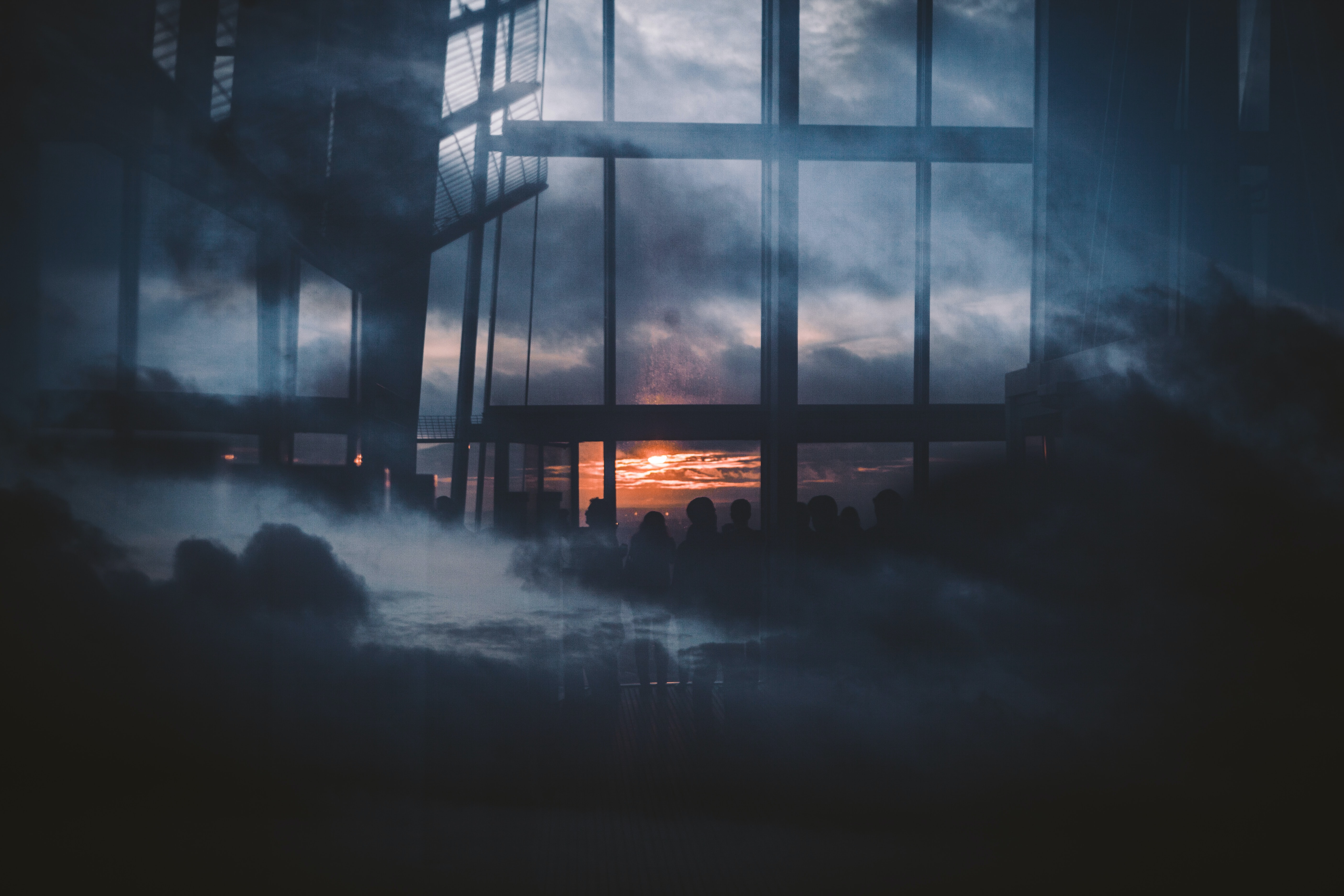 silhouette photography of people standing inside building