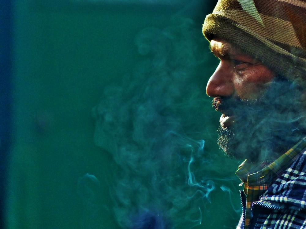 man with trails of smoke
