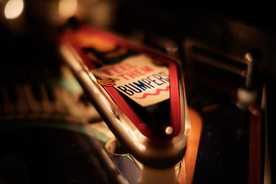 "This is a macro shot of a slingshot on the classic Bally 1976 pinball ""Capt. Fantastic and The Brown Dirt Cowboy"". The slingshots are the triangular objects above the flippers that kick the ball."