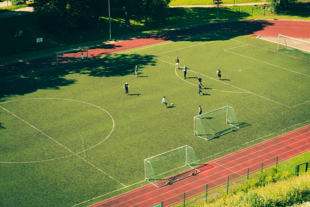 people playing soccer on soccer field