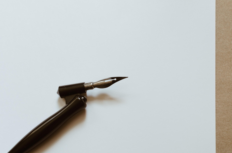 fountain pen on white paper