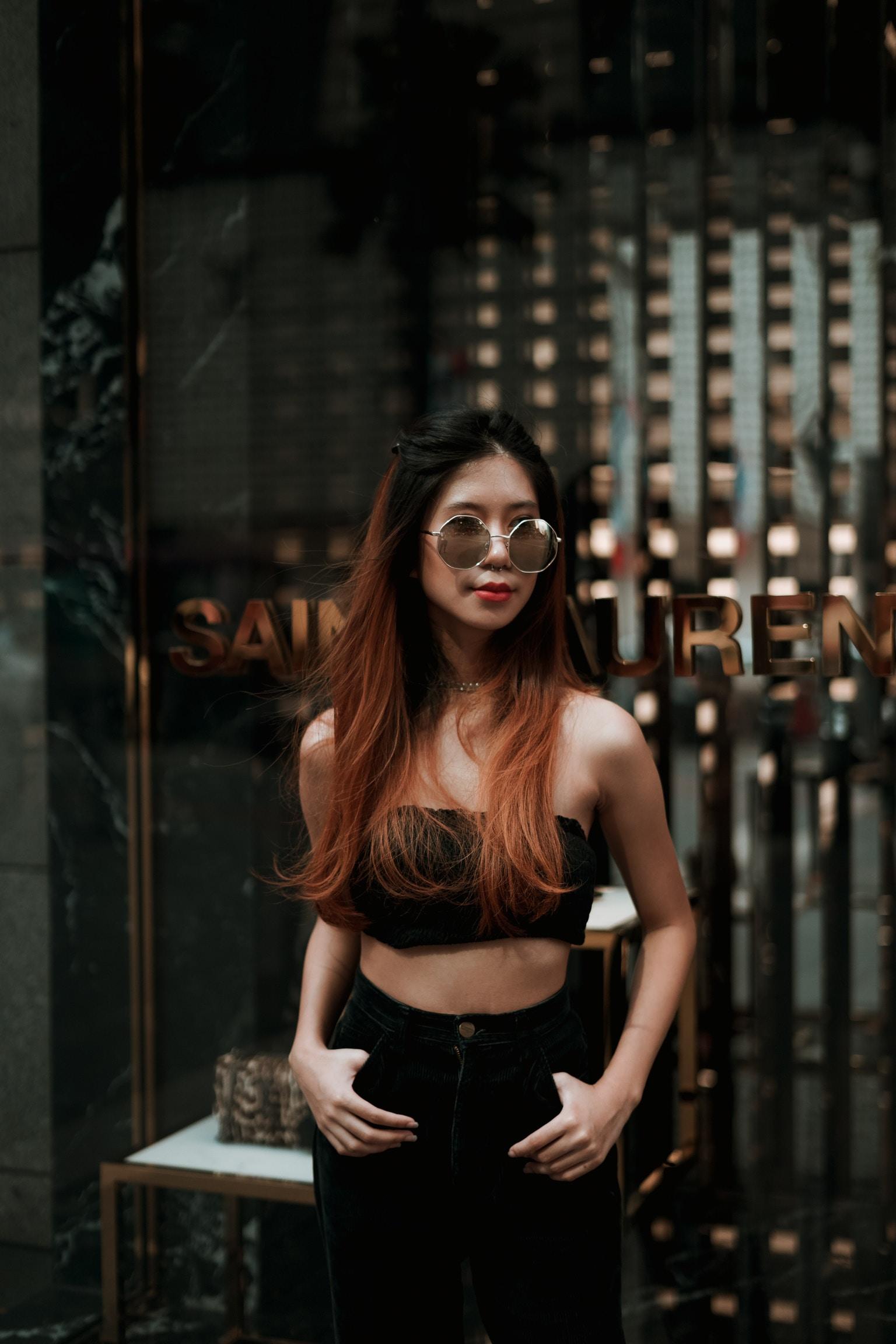 woman in black crop top standing near establishment