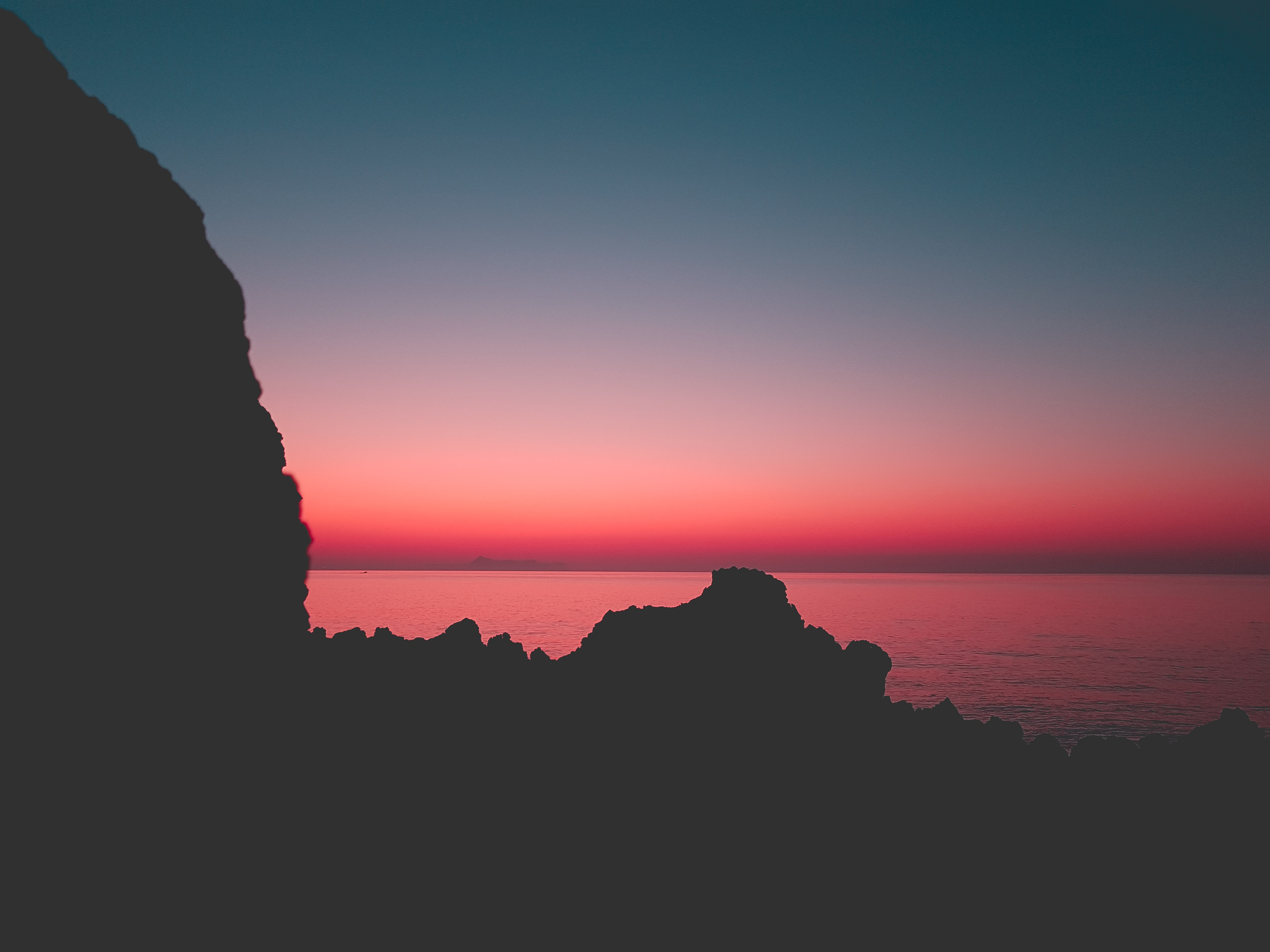silhouette of cliff and sea