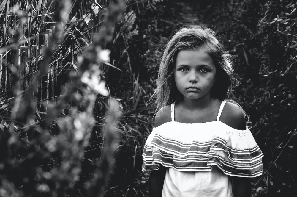 grayscale photo of a girl in garden