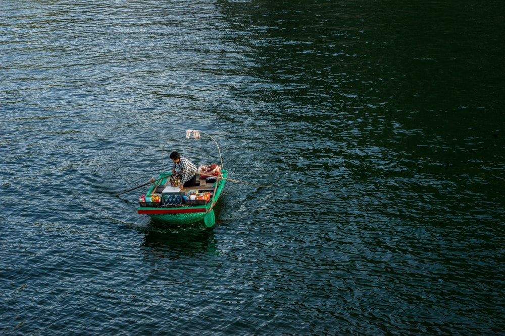 person on green boat