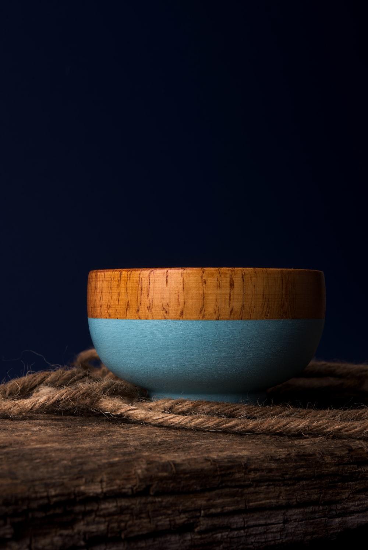 brown and blue ceramic bowl