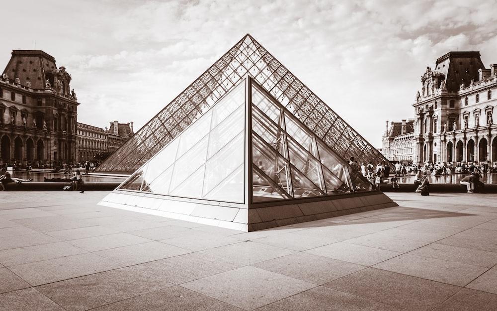 grayscale photo of Louvre Museum, Paris, France