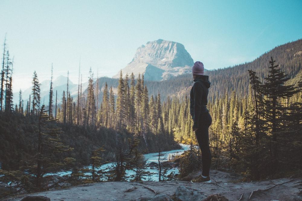 person staring at lake during daytime