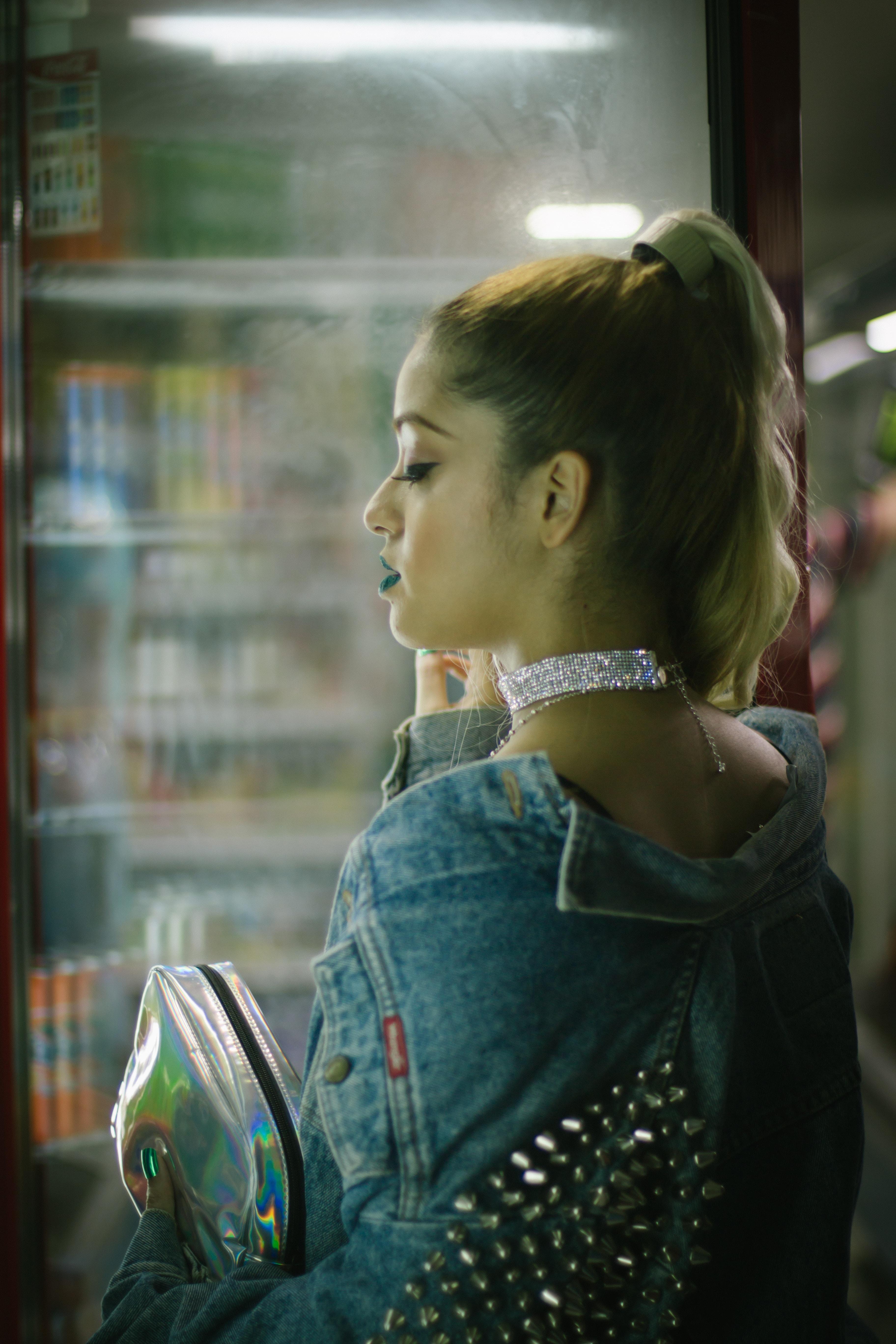 woman standing near the glass facade