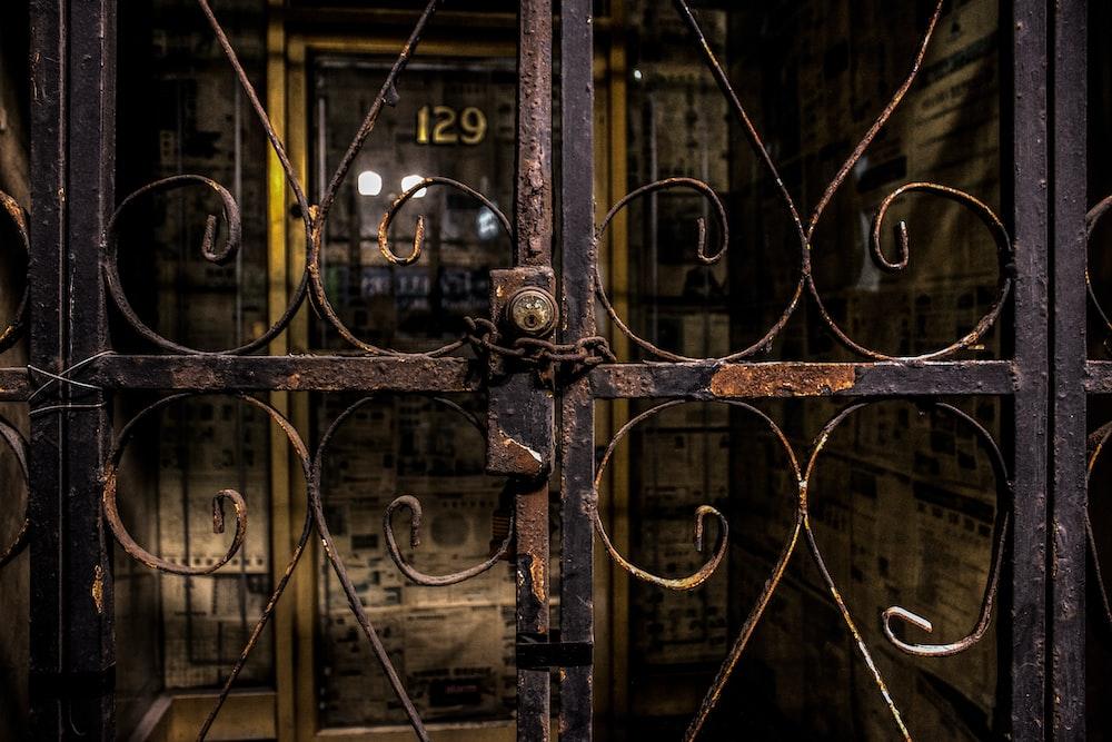 black metal locked gate
