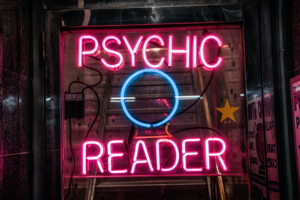 turned on red Psychic Reader neon sign