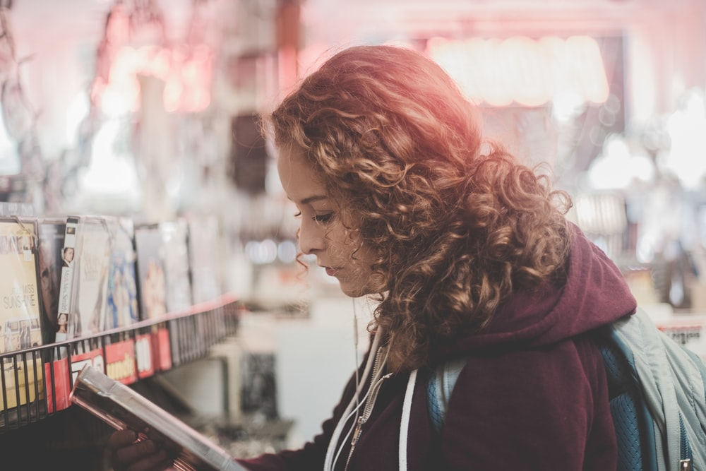 woman reading book in the streets