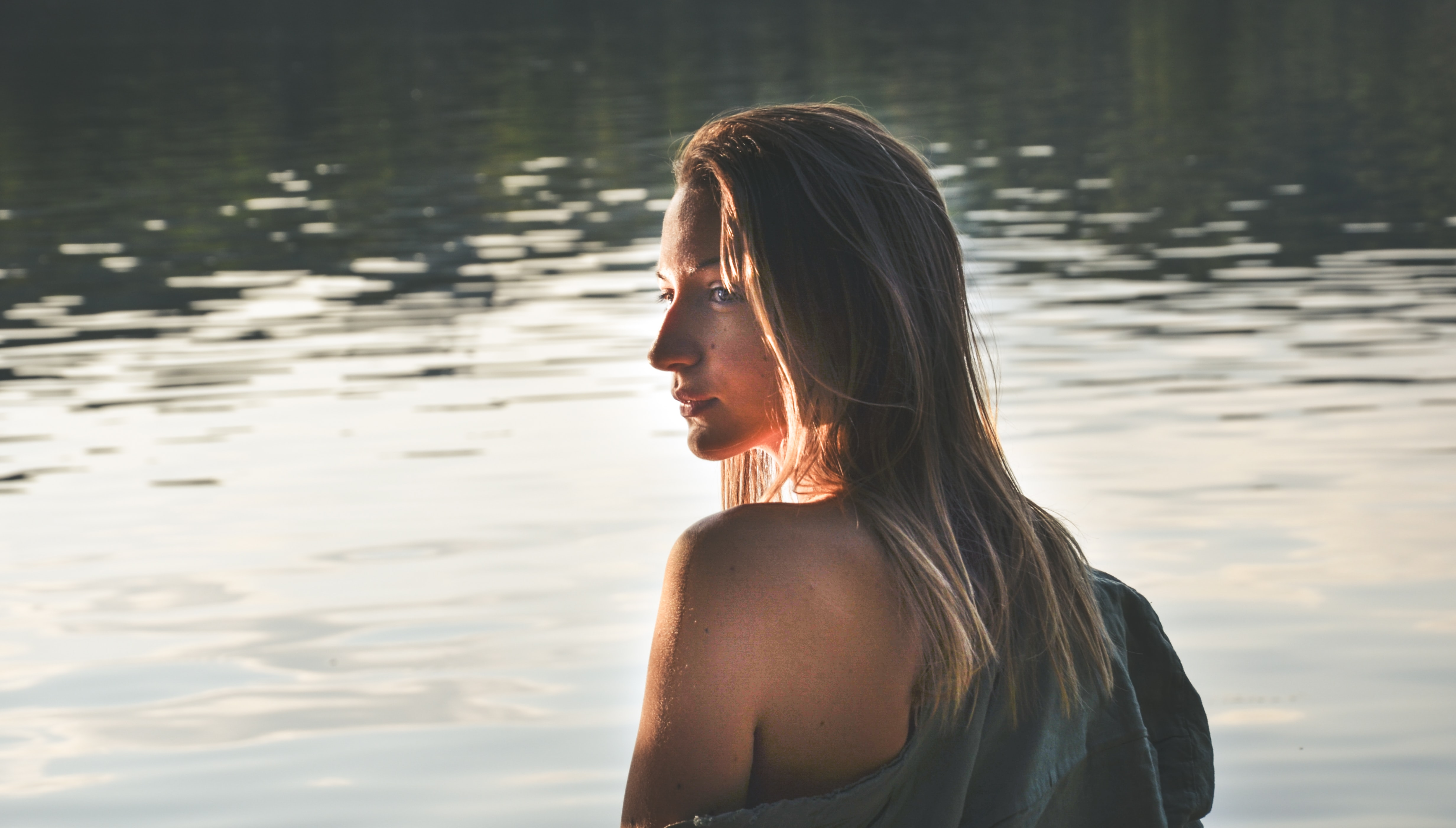 woman with blonde hair on body of water