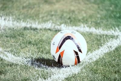 white orange and black soccer