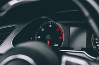 selective focus photography of speedometer